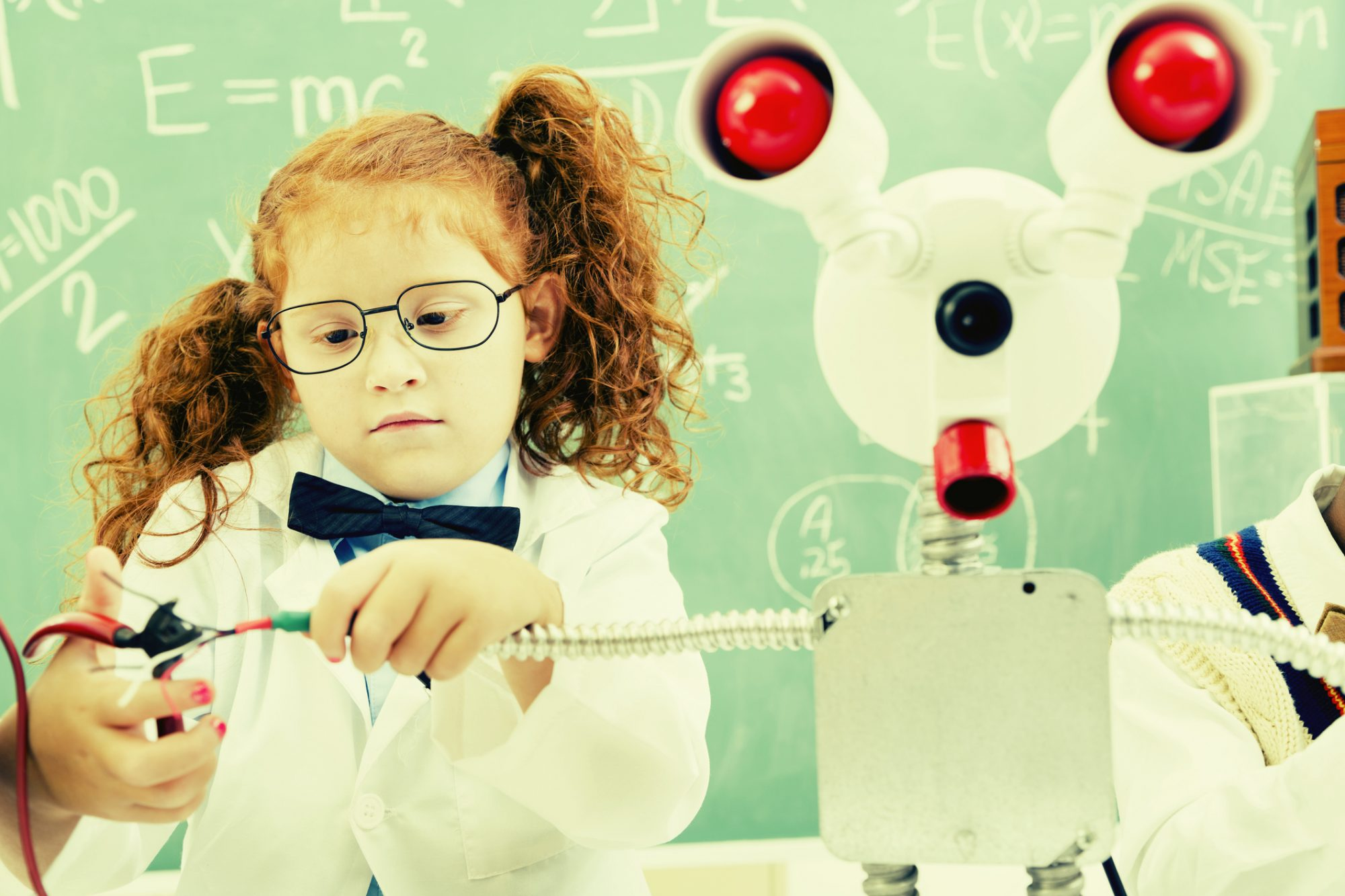 Retro revival image of children in science lab creating their own robot.